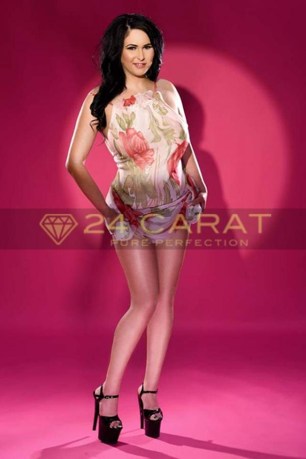 24 Carat Escort Emily in a floral dress