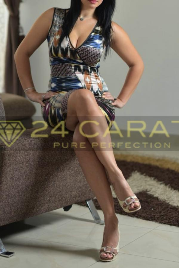 24 Carat Escort Mabel posing in a gorgeous multicoloured dress